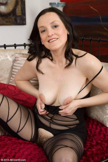 37 year old brunette mature Emily Marsha making her lingerie look fantastic at AllOver30