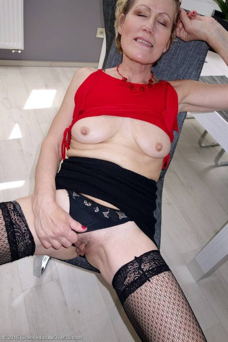 Mature hottie Georgina C showing off her shaved pussy at AllOver30