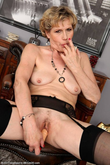 Mature babe Georgina C playing with her toy at AllOver30