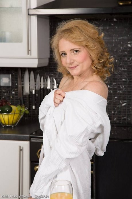 Perky 45 year old Isabelle B enjoying the kitchen counter at AllOver30