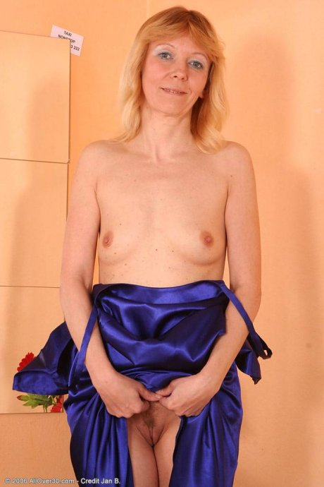 Blonde mature housewife Monika still has a smoking hot body at AllOver30