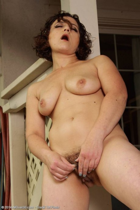 Busty mature Anna P shows off her hairy pussy at AllOver30