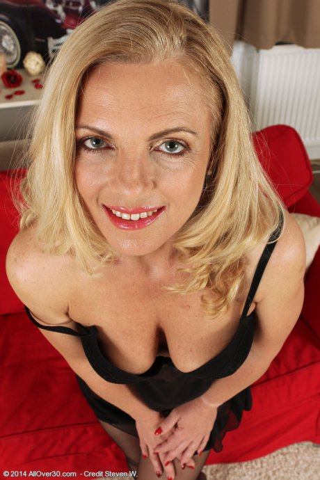 Blonde naughty housewife Britney spreads her stocking covered legs at AllOver30