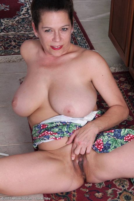 Busty MILF Christy showing her big tits at AllOver30