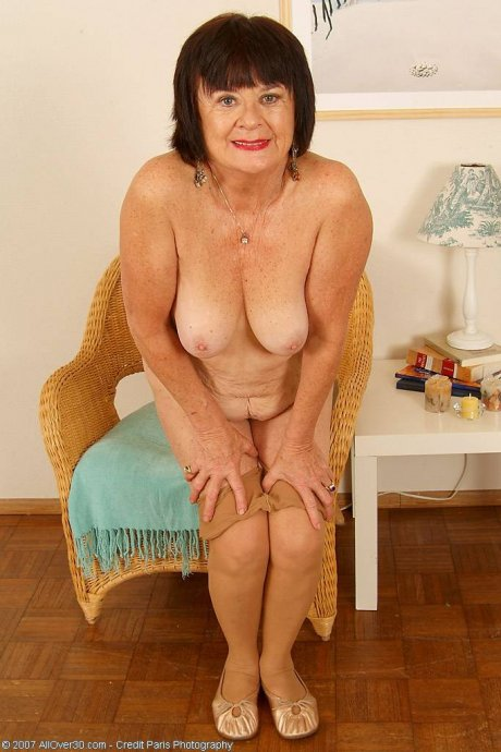 Older mature Mona strips off her clothes showing moist pussy at AllOver30