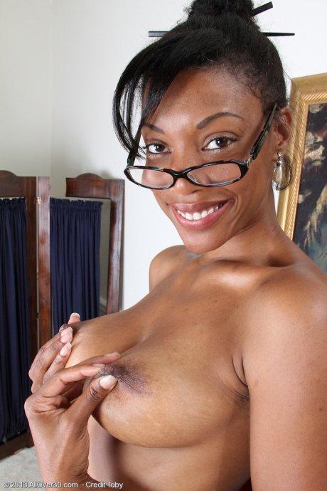 Hot ebony Jayden spreads her pink slit on her desk at AllOver30