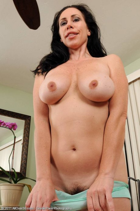 Mature housewife Kira I slips off her blus panties and squeezes tits at AllOver30