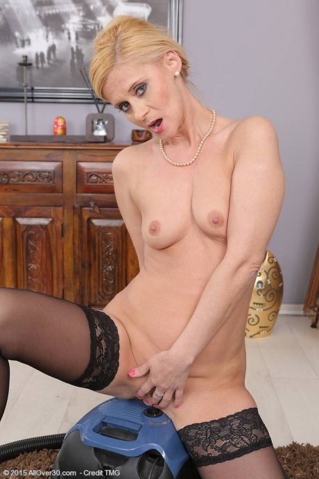 Blonde housewife Starlet gets naked and plays at AllOver30