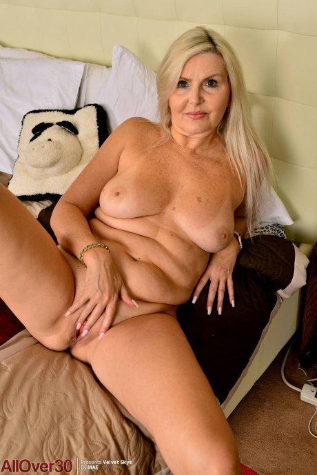 Blonde Canadian mature Velvet Skye shows off her shaved pussy at AllOver30