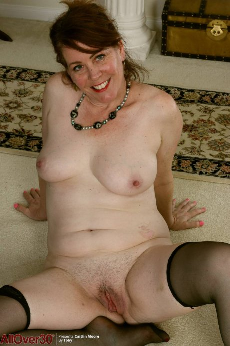 Mature Caitlin Moore shows off her unshaved pussy at AllOver30