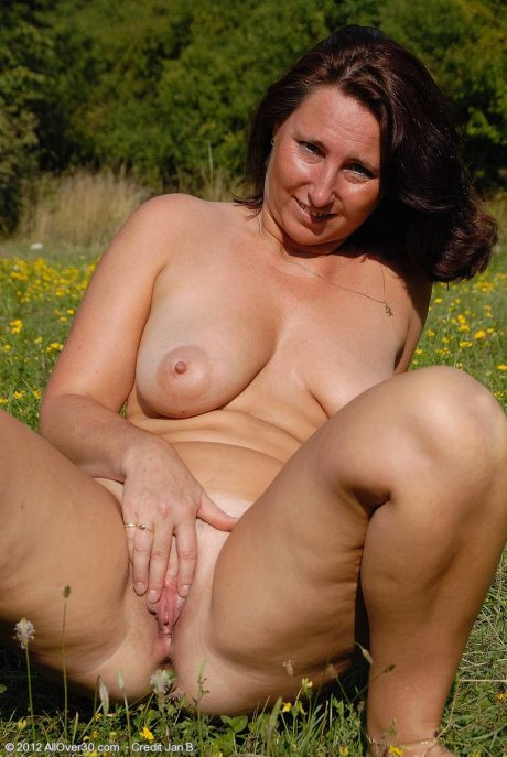 MILF Demi sets her mature tits free in the farmers field at AllOver30