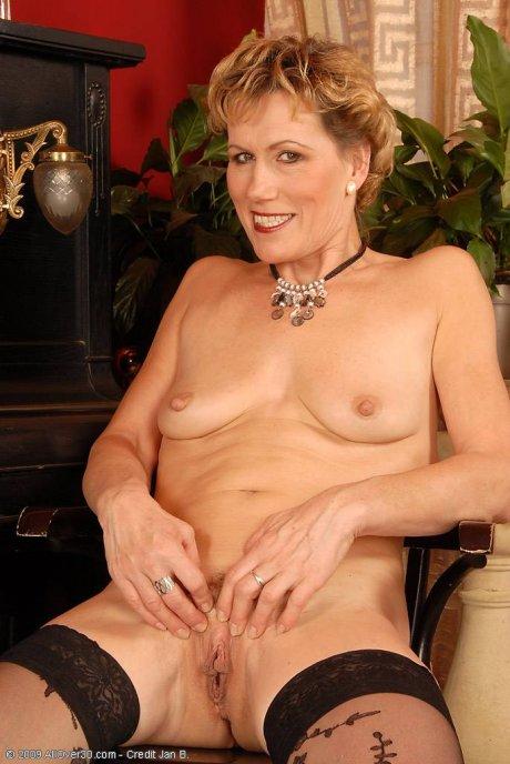 Mature Georgina C shows off in her black lingerie at AllOver30