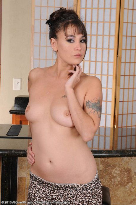 Exotic Asian MILF Jade Hsu strips down for a little playtime at AllOver30