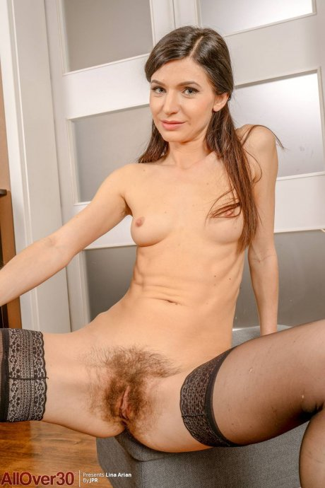 Mature Lina Arian shows off her hairy pussy at AllOver30