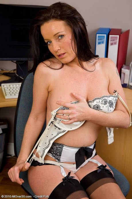 Brunette Marlyn gets sexy in her office and spreads open her pussy at AllOver30