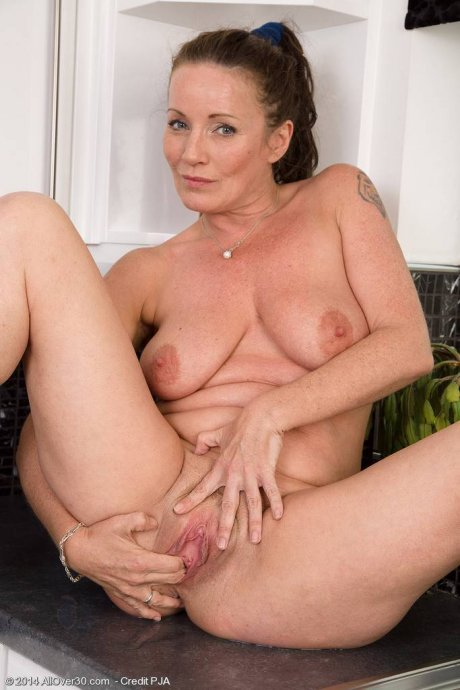 Hot babe Marlyn masturbate in the kitchen at AllOver30