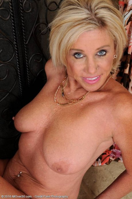 Hot blonde housewife Payton Hall show off her big breasts at AllOver30