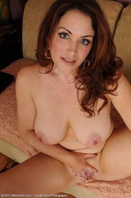 MILF Ryan displaying her all natural boobs at AllOver30