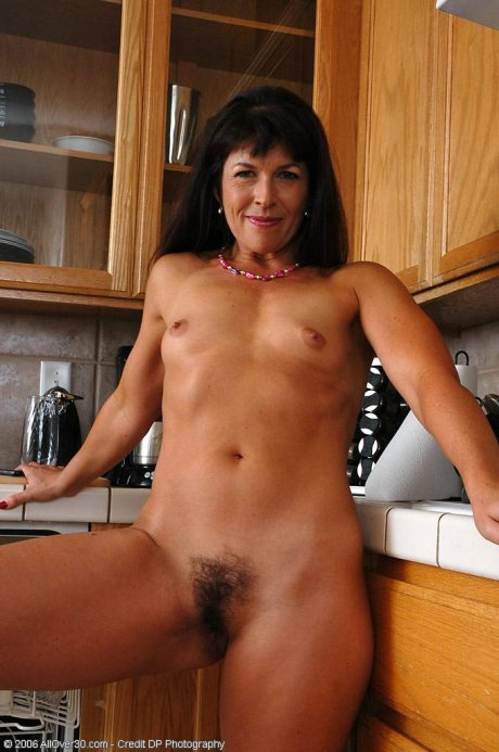 Brunette MILF with a rock solid body and firm ass here at AllOver30