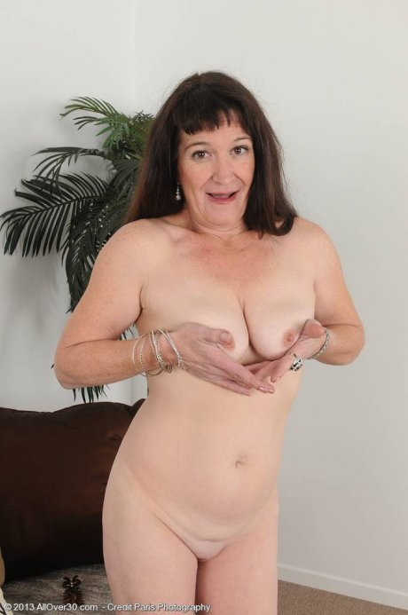 Elegant AnnaD shows off her bald pussy at AllOver30