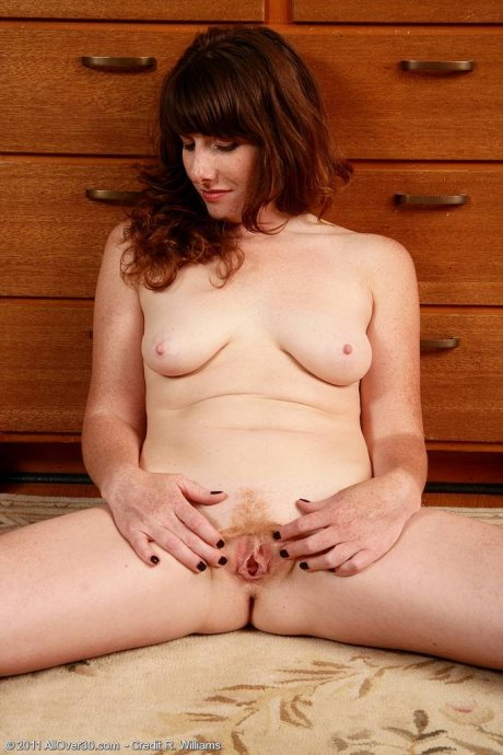 Redhead MILF Ava playing with her pussy at AllOver30