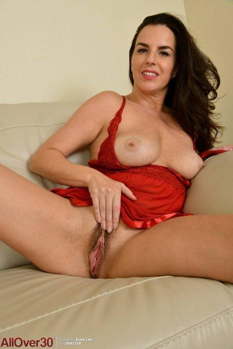 Brunette mature Kobe Lee in red lingerie at AllOver30