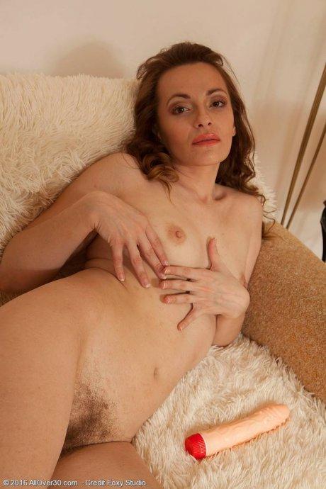 Manuella masturbates her hairy pussy at AllOver30