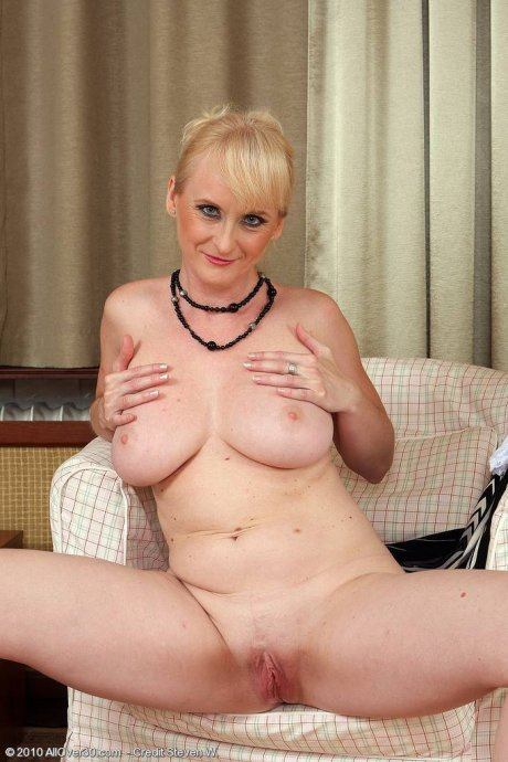 Elegant and mature Monik slips off her evening dress and spreads at AllOver30