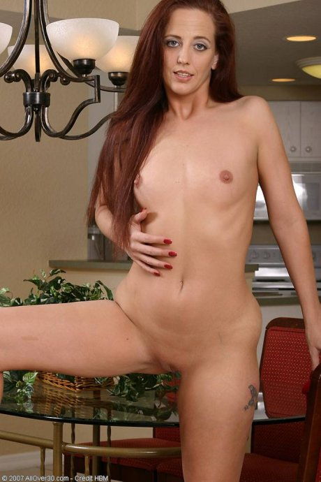 Redheaded MILF Sabrina playing with herself at AllOver30