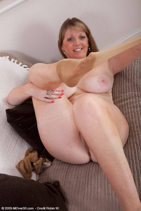 Blonde mom spreads her toes and pussy in this one at AllOver30