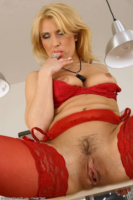 Horny Valentina spreads her lingerie covered legs in this one at AllOver30
