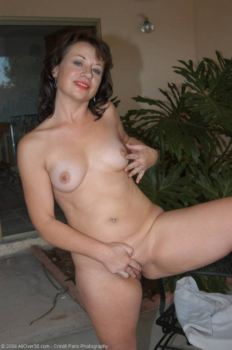 Alannah strips and spreads her pussy outside on the patio at AllOver30