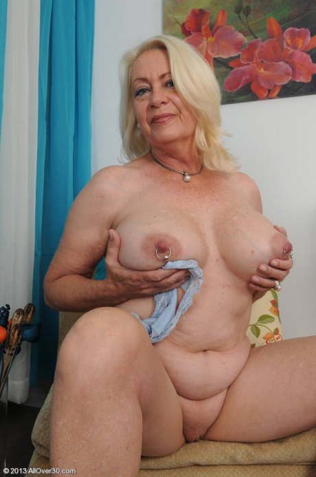 Horny 60 year old Angelique tugs at her mature box at AllOver30