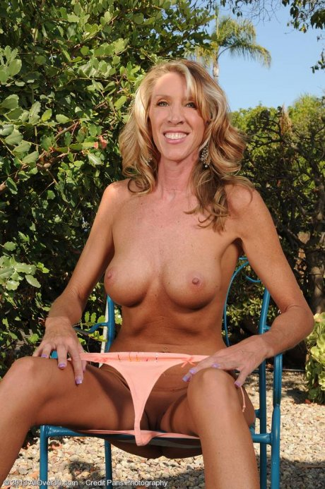 Tall slim blonde Brynn Hunter showing off her full body tan outdoors at AllOver30