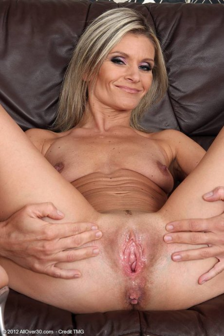 Blonde 39 year old Carley plants a finger inside of her mature pussy at AllOver30
