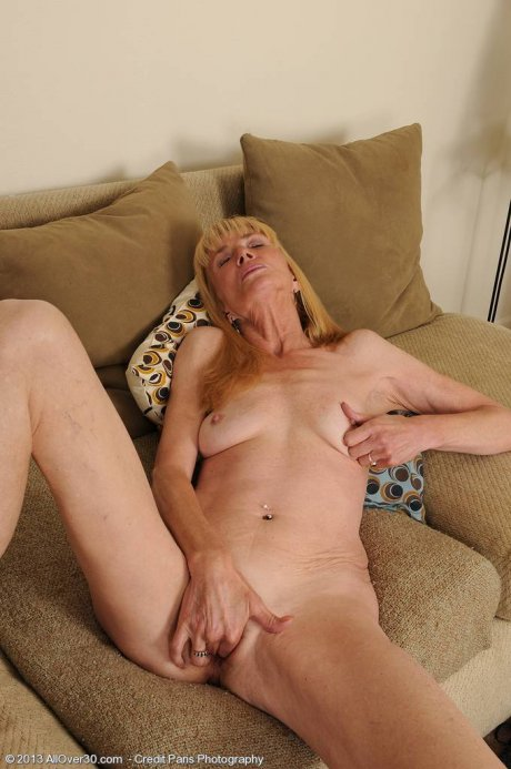 57 year old Pam strips and inserts her fingers deep at AllOver30