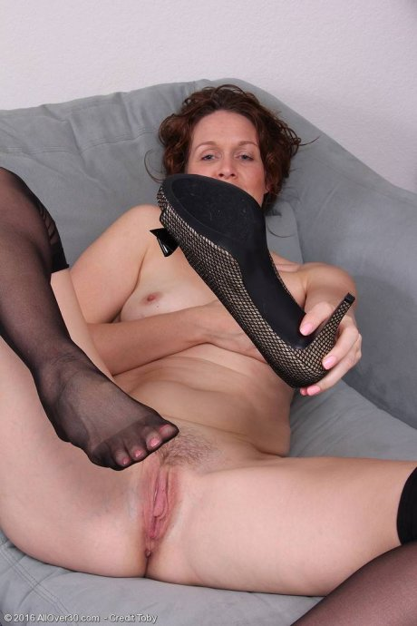 Roxanne Clemens takes off her corset and slips off her nylon stockings for you at AllOver30