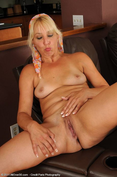 Blonde housewife Andi shows off her shaved pussy at AllOver30