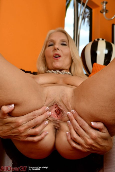 Blonde mature Chery Leigh showing her shaved pussy at AllOver30