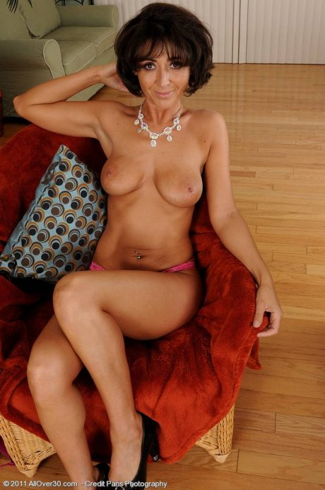 Elegant 37 year old Coral struts her sexy stuff in here AllOver30