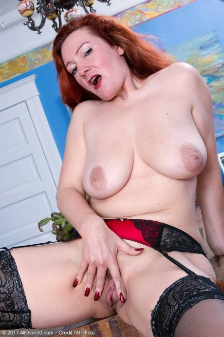 Elegant redhead mature Jessica OHare playing with herself at AllOver30