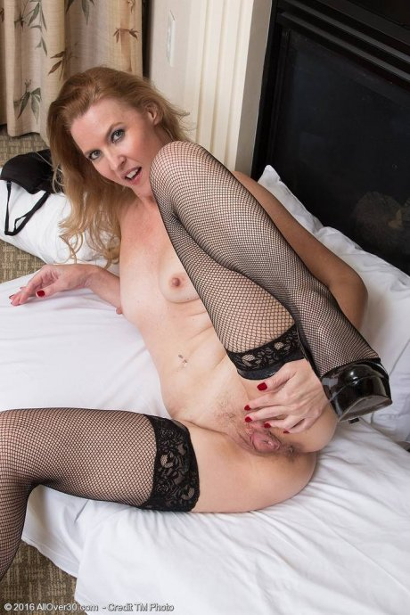 Sultry MILF Lacy F has her sexiest black lingerie on for a fun sensual evening at AllOver30