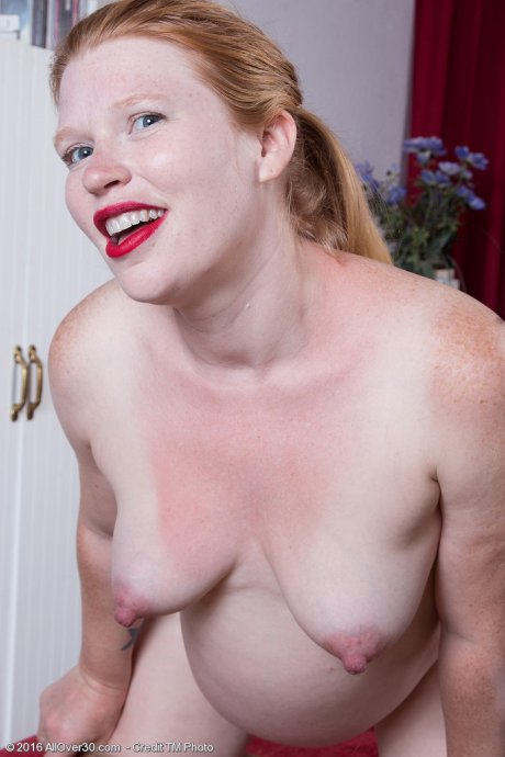 Preggo redhead Madison Young plays with her hairy pussy at AllOver30