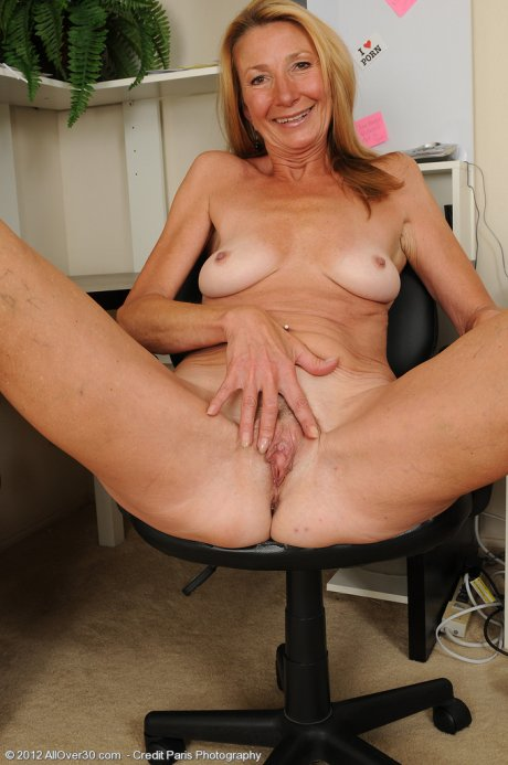 Skinny 56 year old Pam takes a break from her office work to spread at AllOver30