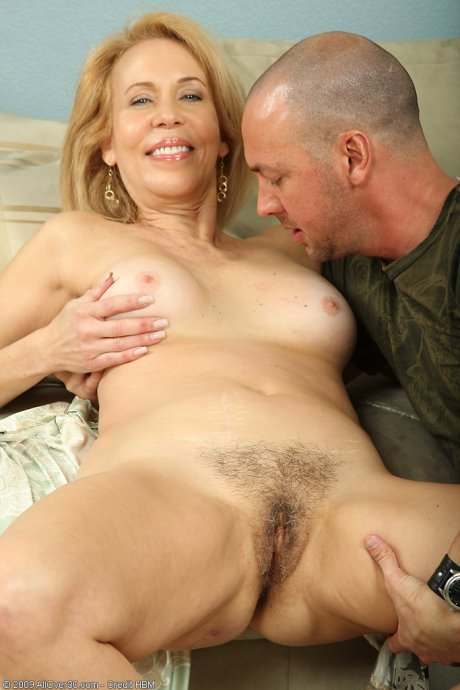 Hot blonde MILF enjoying a younger cock in her again pussy at AllOver30