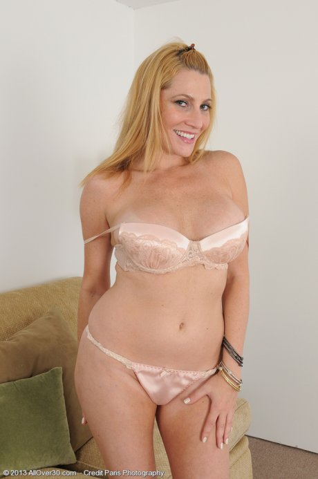 Sexy and elegant Jennifer Best strips and spreads her tiny pussy at AllOver30
