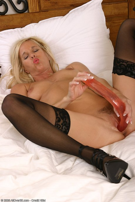 Blonde MILF has fun with a double ended dildo in here at AllOver30