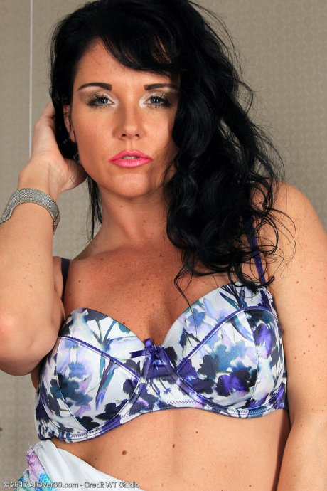 Leah H undresses and plays at AllOver30