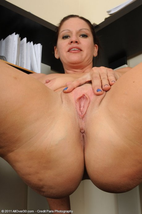 39 year old Xena strips and spreads at the office at AllOver30