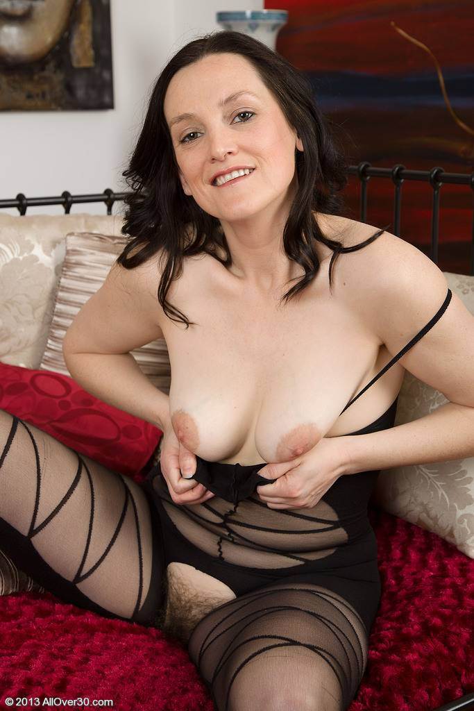 37 year old brunette mature Emily Marsha making her lingerie look fantastic at AllOver30